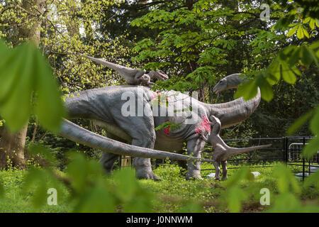 Apatosaurus & Deinonychus Raptors, Jurassic Kingdom, Osterley Park, London - Stock Photo