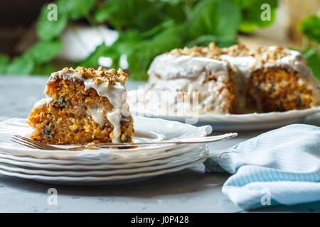 Carrot cake with walnuts, dessert in the garden, selective focus - Stock Photo