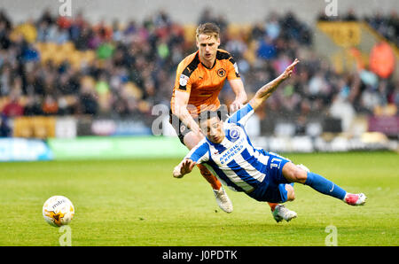Anthony Knockaert of Brighton is brought down during the Sky Bet Championship match between Wolverhampton Wanderers - Stock Photo