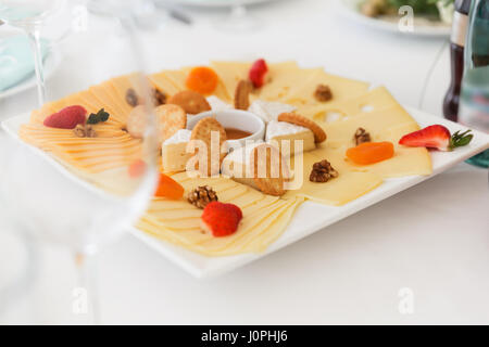 Perfect party cheese board on a table - Stock Photo