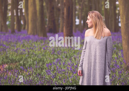 Blonde Woman in a Bluebell Wood, Wiltshire - Stock Photo