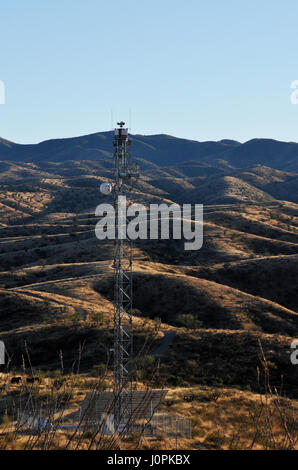Radar technology on a tower that has a camera mounted on top aids U.S. Border Patrol agents along the international - Stock Photo