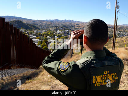 U.S. Border Patrol agent speaks about the work of agents along the international border with Mexico in Nogales, - Stock Photo