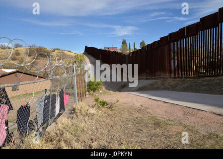 A wall separates Nogales, Arizona, USA from Nogales, Sonora, Mexico, as seen from Arizona. - Stock Photo