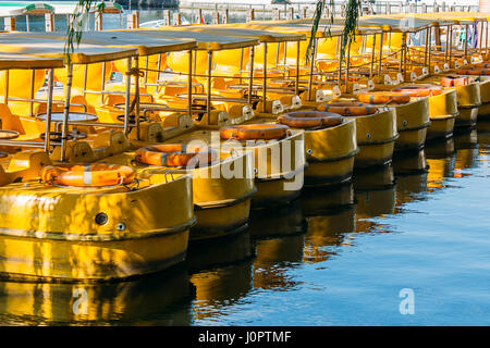 Yellow Boats on Qianhai lake in Shichahai lake of Beijing China - Stock Photo