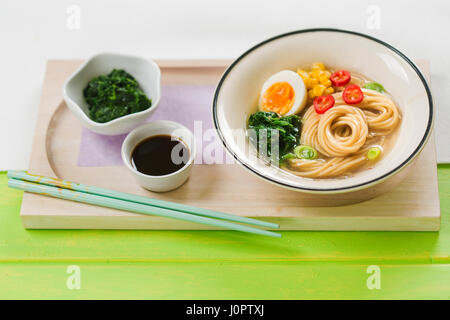Ramen noodle soup with spinach and soy sauce - Stock Photo