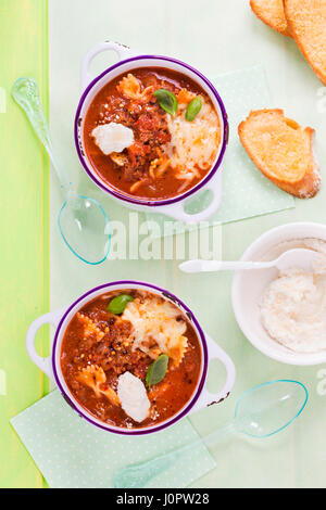 Lasagne pasta soup with ricotta and basil - Stock Photo