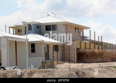 Brick home under construction in residential estate - Stock Photo