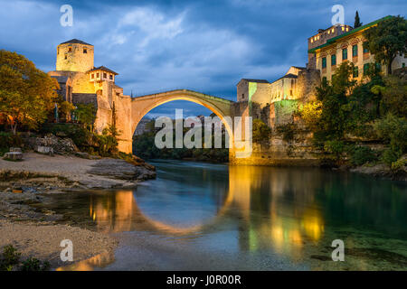 Old Bridge at night in Mostar, Bosnia and Herzegovina - Stock Photo