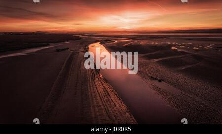 Sunset at low tide on the Loughor Estuary, Penclawdd, North Gower, Swansea. - Stock Photo