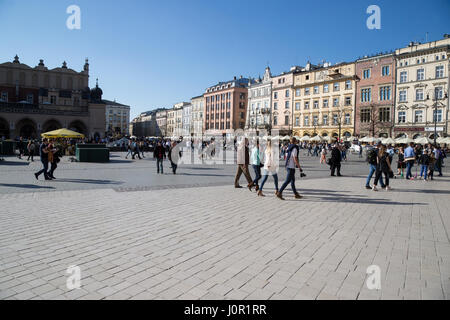 Tourists in the main market in Old Town Krakow - Stock Photo