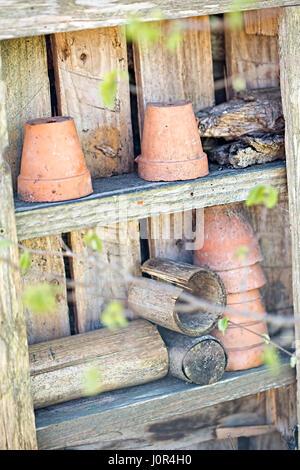 Spring garden wooden shelf with ceramic pots - Stock Photo