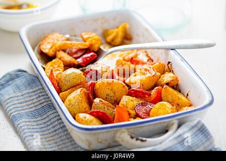 Chorizo, potato, red pepper onion tray bake - Stock Photo