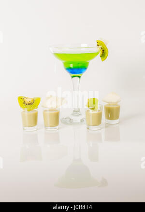 Colorful drink in a margarita glass, blue and green combination, many drinks in a shotglass, party set - Stock Photo