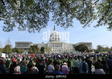 Washington, USA. 15th Apr, 2017. Protestors take part in the 'Tax March' to call on U.S. President Donald Trump - Stock Photo