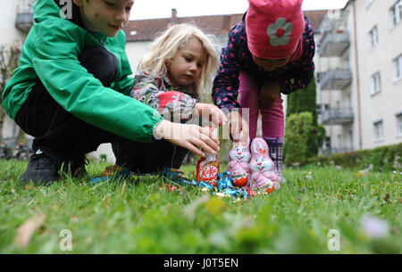 Munich, Germany. 16th Apr, 2017. Luke (l-r), Leia and Kylie search for the Easter bunny and Easter eggs in a yard - Stock Photo