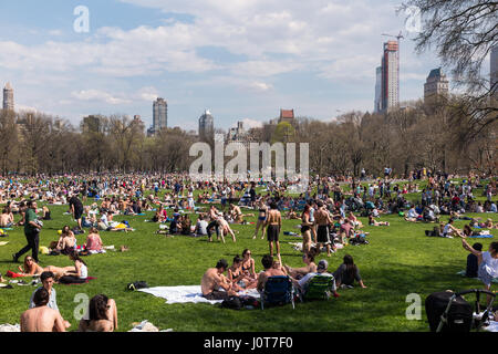 New York City, USA. 16th Apr, 2017. People enjoying record breaking temperatures on a sunny Easter Sunday on the lawn of Central Park in New York City, USA Credit: Greg Gard/Alamy Live News