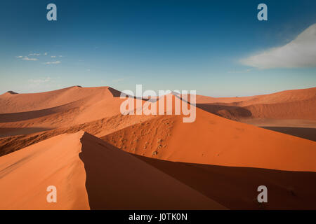 Orange and red sand dunes in the Namib Naukluft, Namibia, Sossusvlei - Stock Photo