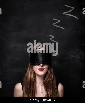 Blindfolded man sleeping - Stock Photo