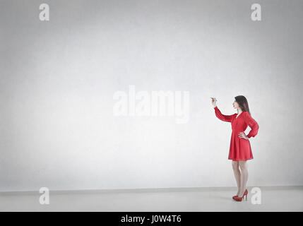 Woman in red dress planning - Stock Photo