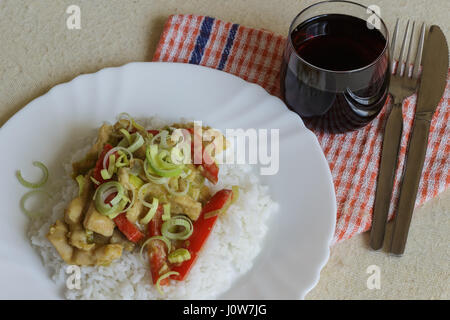 Vietnamese food - roast chicken meat with vegetables and rice on a white plate - Stock Photo