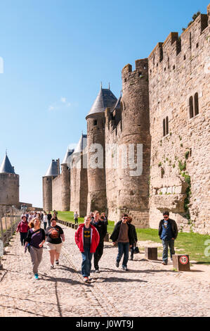 Visitors to the fortifications of the old Cite of Carcassonne in le Midi,southern France, restored by Eugène Viollet - Stock Photo