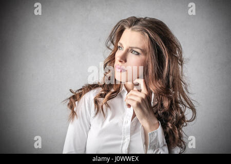 Brunette businesswoman thinking - Stock Photo