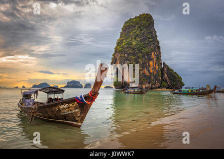 Phra Nang beach, Railay, Krabi province, Thailand: longtail boats in front of Happy Island - Stock Photo