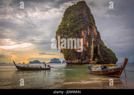 Phra Nang beach, Railay, Krabi province, Thailand: longtail food vendor boats in front of Happy Island - Stock Photo