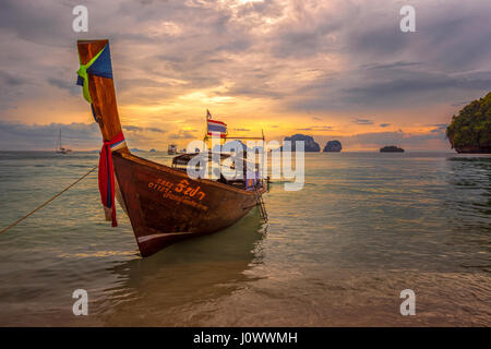 Ao Nang beach, Railay, Krabi province, Thailand: longtail boat at sunset - Stock Photo