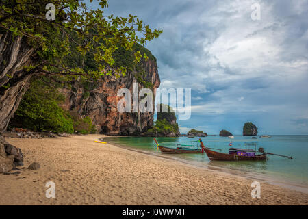 Phra Nang beach, Railay, Krabi province, Thailand: longtail boats and  Princess Cave - Stock Photo