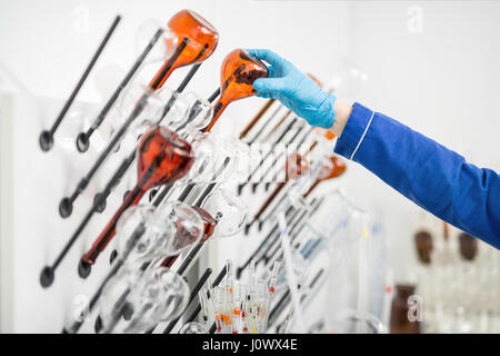 Glass beakers in lab - Stock Photo