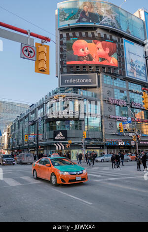 Yonge-Dundas Square, Dundas Square intersection, pedestrian scramble, taxi cab, advertising billboards, downtown - Stock Photo
