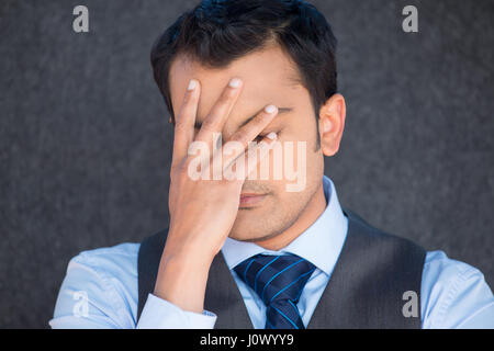 Closeup portrait, young adult man, sad depressed, stressed, alone, disappointed, gloomy, hand covering face, isolated - Stock Photo