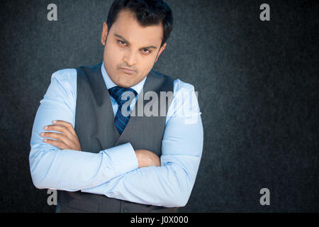 Closeup portrait, displeased, angry, grumpy business man, bad attitude, arms crossed, folded, looking at you, isolated - Stock Photo