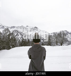 Rear view of boy looking at view, Alps, Braunwald, Switzerland - Stock Photo