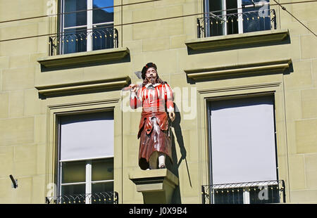 The frontage of the guild house in the Kramgasse is decorated with the Butcher's statue, Berne, Switzerland. - Stock Photo