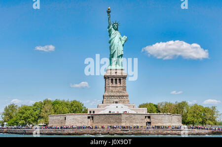 New York, USA - 22 May 2015. Tourists visiting an iconic sculpture on a sunny day of May. The Statue Of Liberty - Stock Photo