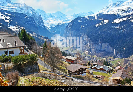 The view on the Lauterbrunnen valley, surrounded vy snowbound rocks, fro mthe viewpoint in Wengen resort, Switzerland. - Stock Photo