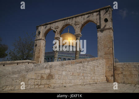 The Dome of the Rock on the Temple Mount as seen through Slender Arches on which scales will be hung in the End - Stock Photo
