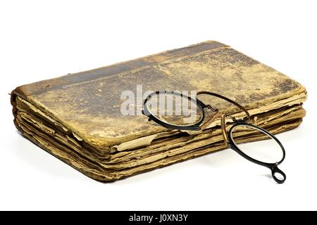 antique book with pince-nez isolated on white background - Stock Photo
