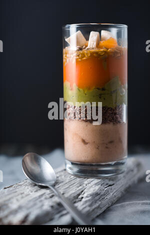 Banana smoothie, flax seed, avocado pumpkin layers vertical - Stock Photo