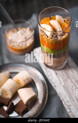 Smoothies and banana slices and biscuit on a tin plate vertical - Stock Photo