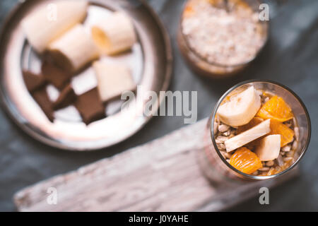 Smoothies and banana slices and biscuit on a tin plate horizontal - Stock Photo