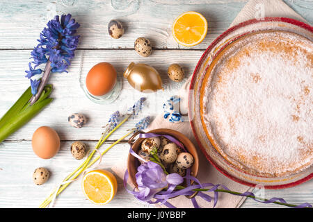 German Easter cake with decoration and flower on the white wooden table horizontal - Stock Photo