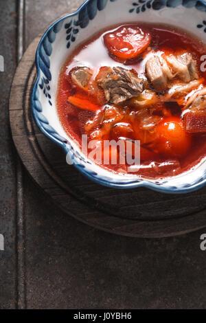 Traditional Russian and Ukrainian beetroot soup borscht vertical - Stock Photo