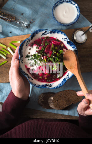 Woman eating traditional beetroot soup borsch top view - Stock Photo