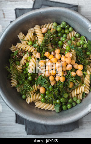 Vegetarian pasta with peas and mint  in the metal bowl top view - Stock Photo