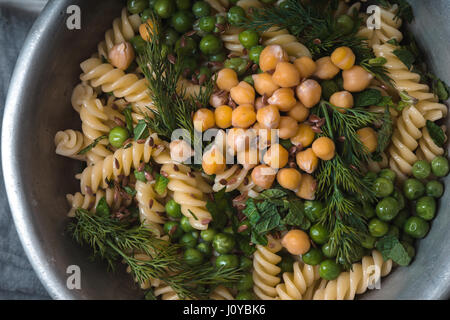 Vegetarian pasta with peas and mint  in the metal bowl horizontal - Stock Photo