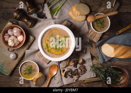 Mushroom soup puree in ceramic bowls three servings - Stock Photo